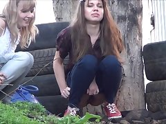 Voyeur spying girls pissing outdoor