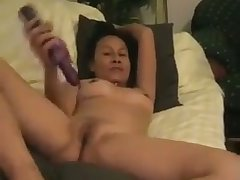 Petite full-grown Asian hoe loves to fuck herself back her rabbit vibrator