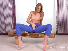 This babe loves wetting her leggings and she is seductively sexy