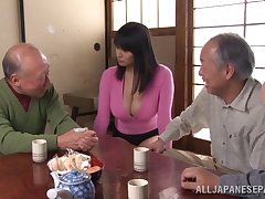 Bosomy Japanese babe exposes her inflate to the old men to tease it with a vibrator