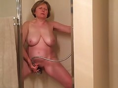 I gave this old whore 100 dosh to masturbate for me in the shower
