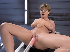 Short prickle Dee Williams penetrated in both holes with a have a passion gear