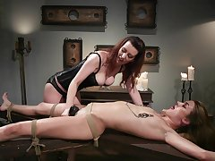 Lezdom session takes a kinky twist be advantageous to Domme Cherry Torn and Zoe Sparx