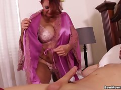 Milf Andi James sucks of a hung scantling in the bedroom.