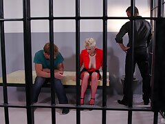 Mature undresses in prison to roger a pair of horny studs