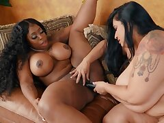 Chocolate invited big-boobied white MILF to do is around her pussy
