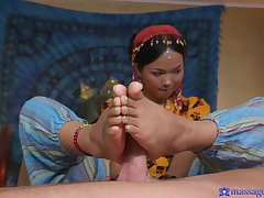 A stud gets tissue massage from hot tattooed Thai massseuse